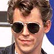 Grease star 'fights for his life'