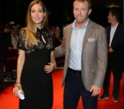 Guy Ritchie and girlfriend Jacqui debut baby bump at Dark Knight rises premiere