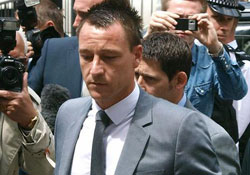 John Terry celebrates being cleared of racist charges on a luxury yacht