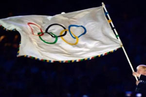 Brazil welcomes the Olympic flag as it lands in Rio