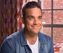 Robbie Williams scheduled to perform for a limited audience this September