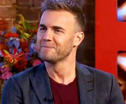 Gary Barlow honoured and reunited with Take That band mates